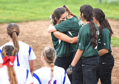 KRISTIN BAUER | CHRONICLE Elyria Catholic High School pitcher Ashley Cascio (1) hugs shortstop Sam Filiaggi (8) after the Elyria Catholic panthers lost to Tuslaw High School on Wednesday evening, May 24.