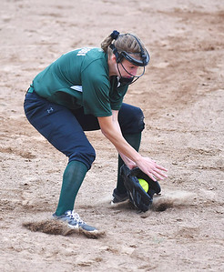 KRISTIN BAUER | CHRONICLE Elyria Catholic High School shortstop Sam Filiaggi (8) fields a ground ball hit during a game against Tuslaw on Wednesday, May 24.