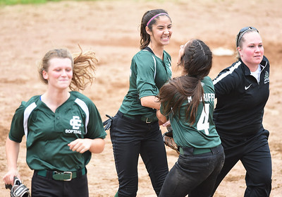KRISTIN BAUER | CHRONICLE Elyria Catholic High School center fielder Stephanie Griffin (2) is congratulated by her twin sister and teammate Kaylie Griffin (4) after making a diving catch in center field on Wednesday, May 24 during a game against Tuslaw.