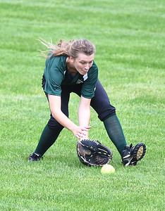 KRISTIN BAUER | CHRONICLE Elyria Catholic High School left fielder Maddy Knoth (5) scoops up a ball hit to left during a game against Tuslaw on Wednesday, May 24.