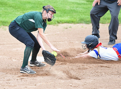 KRISTIN BAUER | CHRONICLE Elyria Catholic High School shortstop Sam Filiaggi (8) narrowly misses tagging out Tuslaw's Cali Frascone (4) on Wednesday, May 24.