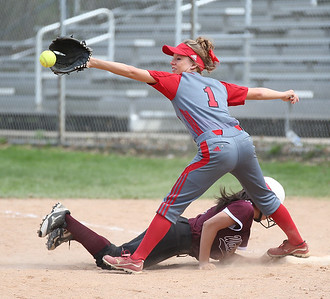 Elyria's Madison Fullmer catches the ball to keep the Walsh Jesuit runner back at first in the Wendy's Tournament at  Brookside Park in Ashland.  Photo by Ray Riedel