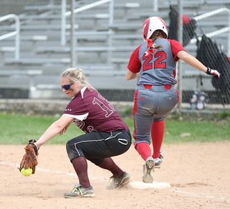 Elyria's Alex Dick beats the ball to first base in the Wendy's Tournament at Brookside Park in Ashland.  Photo by Ray Riedel