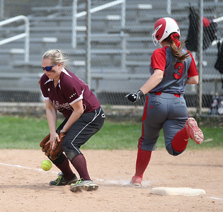 Elizabeth Ellis makes it safe to first before the Walsh Jesuit baseman can capture the ball in the Wendy's Tournament at Brookside Park in Ashland.  Photo by Ray Riedel
