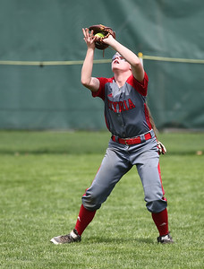 Elyria's Macy Taylor catches a fly ball in the first inning in the Wendy's classic tournament at Brookside Park in Ashland.  Photo by Ray Riedel