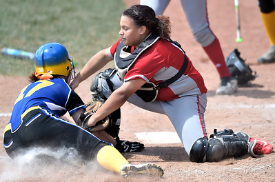 Elyria catcher Maycee Godbolt tags out Kristen Sink of Gahanna Lincoln in the seventh inning. DAVID RICHARD / CHRONICLE