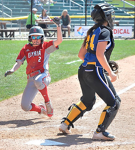 Macy Taylor of Elyria scores a run in the fourth inning. DAVID RICHARD / CHRONICLE