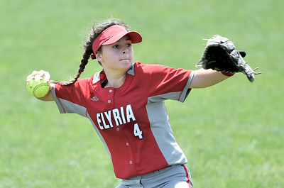 Elyria left fielder Mallory Phares throws to the plate to cut down a runner at the plate in the seventh inning. DAVID RICHARD / CHRONICLE
