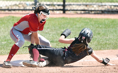 Elyria third baseman April Howser tags out a Lebanon baserunner to complete a double play in the fifth inning. DAVID RICHARD / CHRONICLE