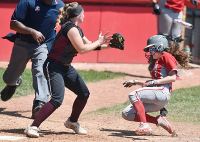 Macy Taylor of Elyria slides home in the bottom of the seventh inning. She was tagged out but then awarded the game-winning run on obstruction against Lebanon. DAVID RICHARD / CHRONICLE