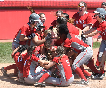 The Pioneers swarm teammate Macy Taylor after she was awarded home plate and the winning run against Lebanon. DAVID RICHARD / CHRONICLE