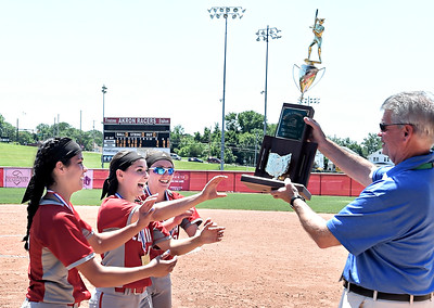 Dierra Hammons, from left, Madison Cruzado and Macy Taylor accept the championship trophy. DAVID RICHARD / CHRONICLE