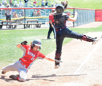 Elyria's April Howser scores the tying run in the seventh inning. DAVID RICHARD / CHRONICLE