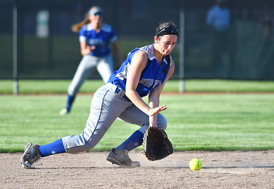 KRISTIN BAUER | CHRONICLE Midview High School second baseman Hailey Ivan (20) stops a ground ball hit during a game against Elyria High School on Tuesday evening, May 16.