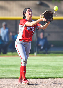 KRISTIN BAUER | CHRONICLE Elyria High School second baseman Dierra Hammons (17) catches a popfly during a game against Midview on Tuesday evening, May 16.
