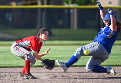 KRISTIN BAUER | CHRONICLE Midview High School's Faith Hamilton (32) slides safely into second base as Elyria High School shortstop Madison Cruzado (12) fails to secure the ball in time on Tuesday evening, May 16.