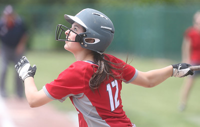 Madison Cruzado looks up as the ball is hit during the game against Parma. BRUCE BISHOP / CHRONICLE