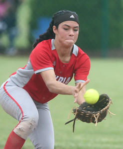 Elyria's Dierra Hammons catches a ball in the infield during the game against Parma. BRUCE BISHOP / CHRONICLE