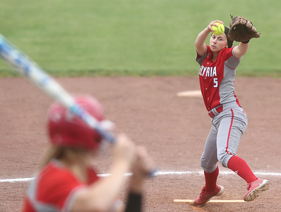 Elyria pitcher Isabella St. Peter winds up as she pitches against a Parma batter. BRUCE BISHOP / CHRONICLE