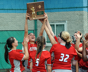 Dierra Hammons holds up the regional championship trophy May 27.  STEVE MANHEIM / CHRONICLE