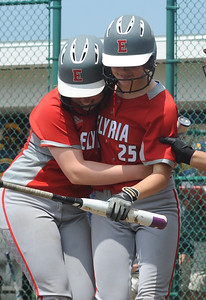 Elyria's April Howser (25) gets a hug from Riley Zana after hitting a two-run homer in the sixth inning May 27. STEVE MANHEIM / CHRONICLE