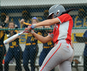 Elyria's Dierra Hammons hits an RBI single in the fourth inning May 27. STEVE MANHEIM / CHRONICLE