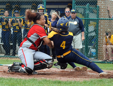 Elyria's Maycee Godbolt tags out Whitmer's Kaylee Keesee at the plate in the fourth inning May 27.  STEVE MANHEIM / CHRONICLE