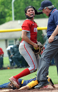 Elyria's Dierra Hammons makes the final out in the Pioneers' win over Whitmer. STEVE MANHEIM / CHRONICLE