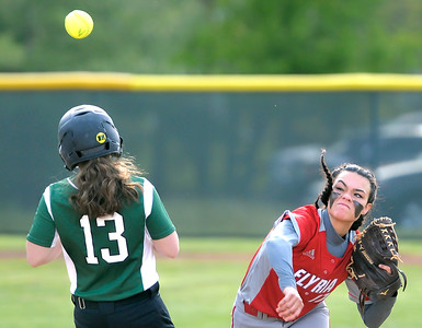 Dierra Hammons, right, throws to first base after a force out of Westlake's Macie Menichini on a fielder's choice yesterday in the first inning. DAVID RICHARD / CHRONICLE