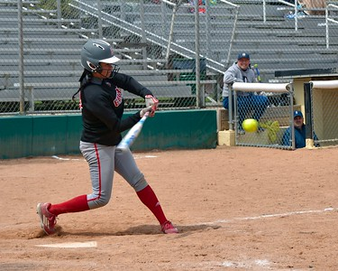 Elyria's Dierra Hammons gets a base hit at the Wendy's Classic on Saturday against Akron Hoban. JESSE GRABOWSKI / CHRONICLE
