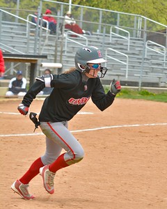 Macy Taylor runs to first base after a hit Saturday at the Wendy's Classic. JESSE GRABOWSKI / CHRONICLE