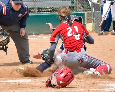 Elyria's Emily Hyer puts down a tag against Akron Hoban during the Wendy's Classic on Saturday. JESSE GRABOWSKI / CHRONICLE