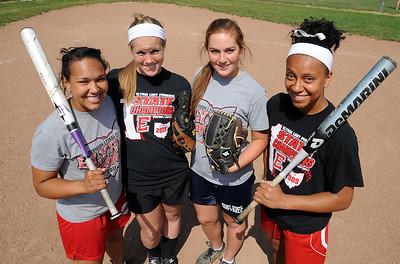 Alanna Williams, left, Stephanie Yonkings, Alyssa Barker and Darien Ward, all seniors on the Elyria High softball team on May 30.  Steve Manheim