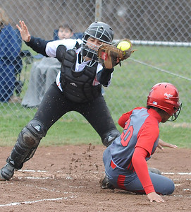 Elyria Sybil Roseboro scores before tag by North Olmsted Rebekah Groden in first inning Apr. 14.  Steve Manheim