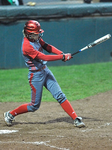 Elyria's Carly Bachna hits an RBI triple in the third inning against Mason. DAVID RICHARD / CHRONICLE