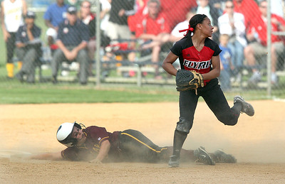 EHS's #5 Darien Ward looks towards the plate after a critical base running mistake by Avon Lake's # 27 Abby Rogers. After over running second base, she stumbled and fell, coming up inches short of the bag, where she was tagged out.