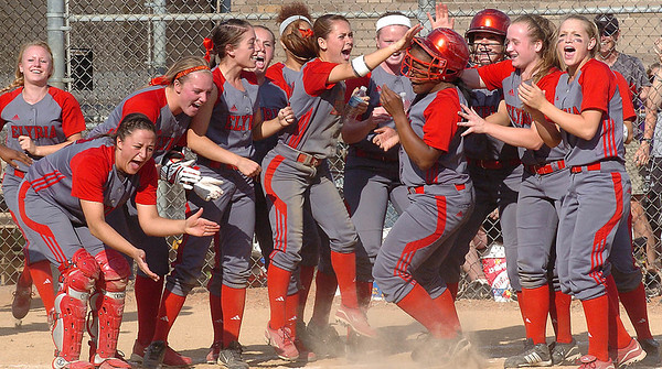 Elyria teammates greet #4 Alexis Roseboro as she crosses home plate following #5's home run.