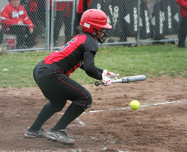 Elyria's #5 Darien Ward lays down a perfect bunt and beat the throw to first with her speed.  photo by Chuck Humel