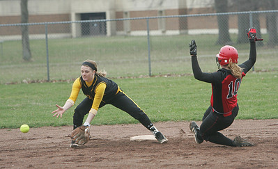 Elyria's #10 Cynthia Woodard would be safe on this steal of 2nd base.  photo by Chuck Humel
