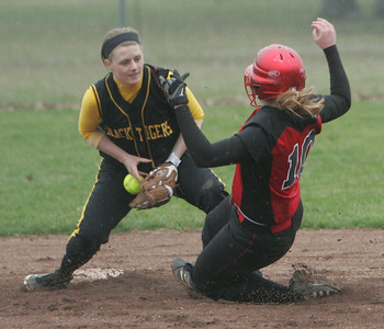 Elyria's #10 Cynthia Woodard would be out on this play of 2nd base as the defender gained control of the throw.  photo by Chuck Humel