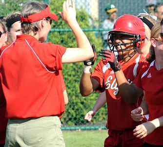 Elyria's Darien Ward is congratulated by trainer Ann Hamker after hitting a solo home run in the fourth inning of regional softball May 26.  Steve Manheim