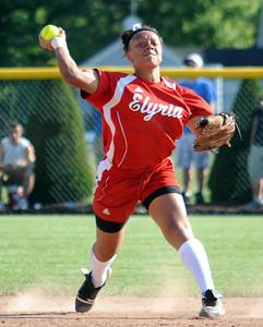 Elyria's Darien Ward makes a put out throw to first base May 26.  Steve Manheim