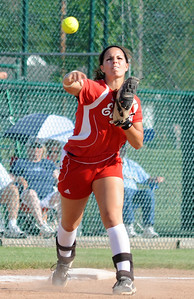 Elyria's Ashlee Stolarski makes a put out throw to first base May 26.  Steve Manheim