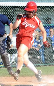 Elyria's Cynthia Woodard scores a run in the fifth inning of regional softball May 26.  Steve Manheim
