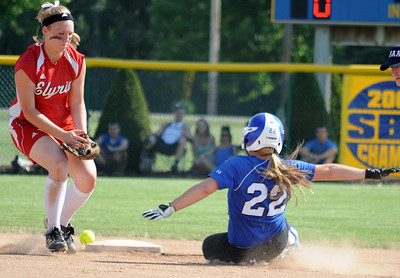 Midview Grace Turner steals second base in front of Elyria Cynthia Woodard in first inning of regional softball May 26.  Steve Manheim