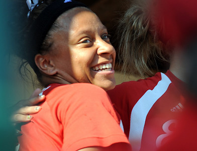 Elyria's Darien Ward celebrates with teammates in dugout after hitting a solo home run in the fourth inning of regional softball May 26.   Steve Manheim