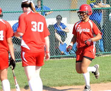 Elyria's Darien Ward at home plate after hitting a solo home run in the fourth inning of regional softball May 26.   Steve Manheim