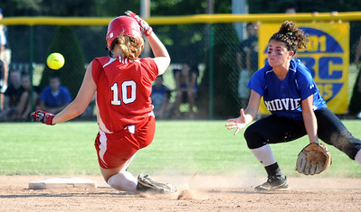 Elyria Cynthia Woodard steals second base before the throw reaches Midview Jillian Kazmierczak in fifth inning of regional softball at Clyde High May 26.  Steve Manheim