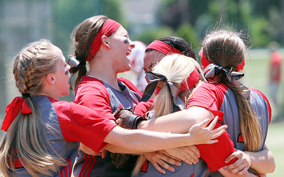 ANNA NORRIS/CHRONICLE The infielders celebrate Elyria's 4-0 victory over Brecksville in the Division I regional championship game Saturday.