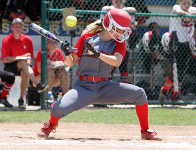 ANNA NORRIS/CHRONICLE Elyria's Madison Fullmer avoids getting hit by Brecksville's Nicole Best pitch in the fifth inning of the Division I Regional 2 championship game at Clyde High School Saturday.